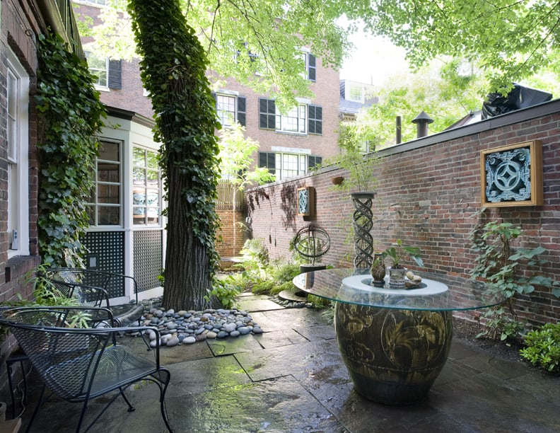 An art-adorned Beacon Hill garden designed by JMMDS. Photo by Thomas Linger.