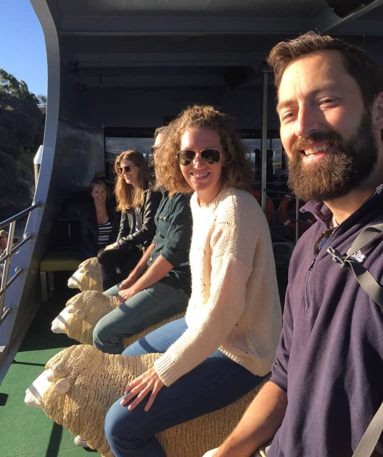 people sitting on sheep-shaped seats on ferry deck