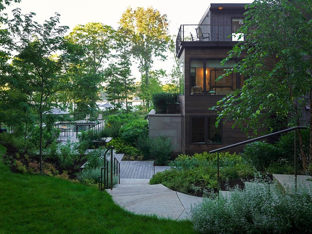 JMMDS-landscape-architecture-maine-coast-modern-home-granite-stairs-path-steel-railing-plank-path-pool-terrace