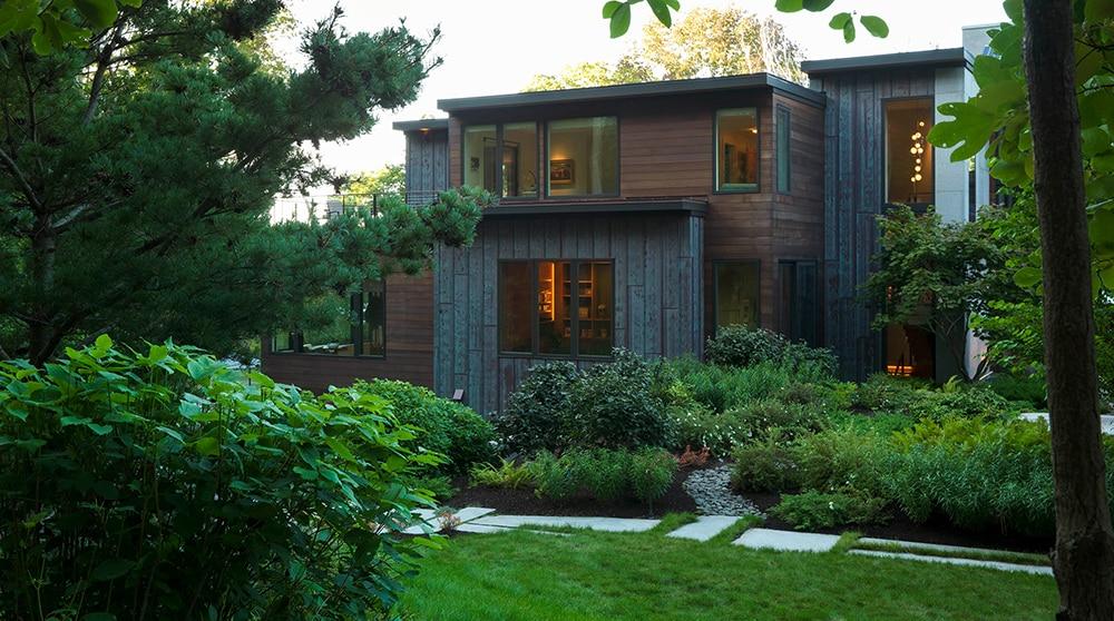 JMMDS-landscape-architecture-maine-coast-modern-home-sideyard-stepping stone path-riverstone-path-pine