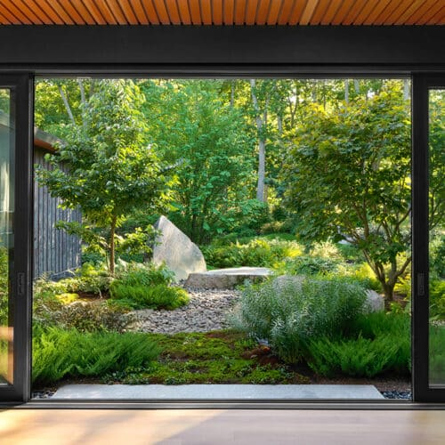JMMDS-landscape-architecture-maine-coast-sliding-window-wall-boulder-riverstone-garden