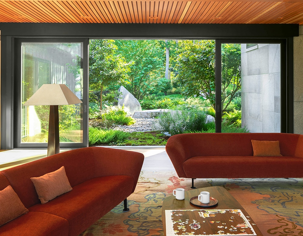 JMMDS-landscape-architecture-maine-coast-sliding-window-wall-boulder-riverstone-garden-living-room-puzzle